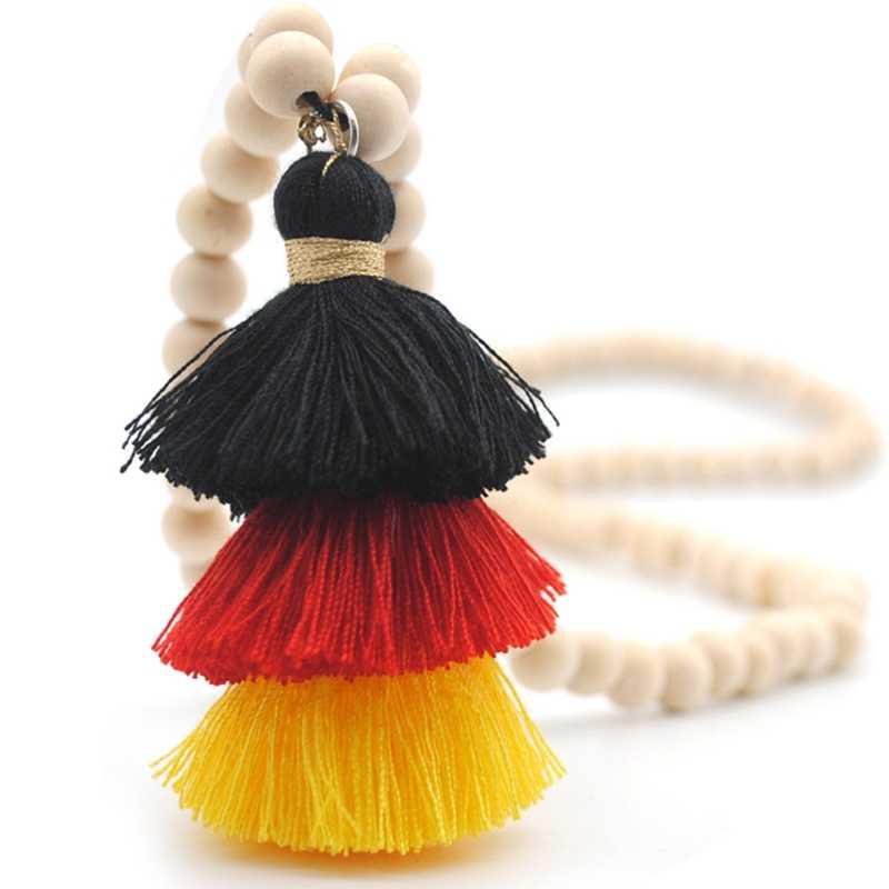 Collar de borla 2019 Festival collar de cuentas de madera Natural 3 capas falda de algodón borlas collar largo Boho
