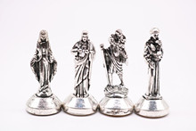 Many styles of Christian decorations. Jesus, Madonna Maria, Rose, Lady Fatima, Figurine. Car dashboard decoration.
