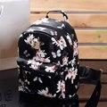 Mujeres lindo bolsas escolares mochila mini 2016 fashion back pack impresión floral negro pequeño de cuero de la pu mochila para adolescentes chicas
