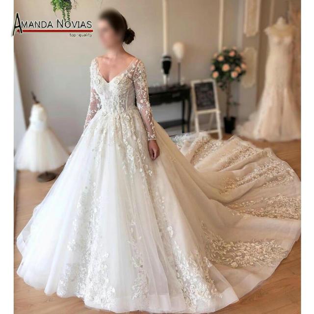 083502aac Elegante mangas largas encaje vestido de novia nuevo diseño 2019 en ...