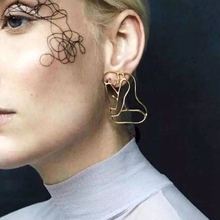 European and American unique hyperbolic stereoscopic human ear nail metal hollowed-out face earring for women abstract retro ear