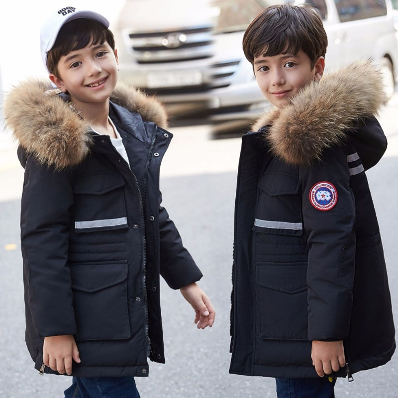 купить Boy's down jacket long section 2018 new Korean version of the big boy thickening large fur collar children's clothing jacke недорого