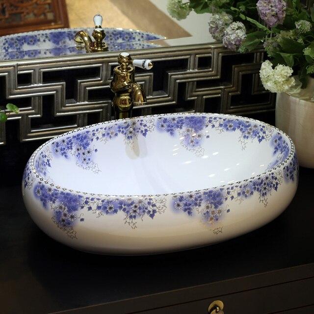 https://ae01.alicdn.com/kf/HTB1eDx1OVXXXXawXVXXq6xXFXXXp/Ovale-Jingdezhen-Sanitari-in-ceramica-lavabo-lavandino-da-Appoggio-Lavata-Bacino-Lavelli-Da-Bagno-di-lusso.jpg_640x640.jpg
