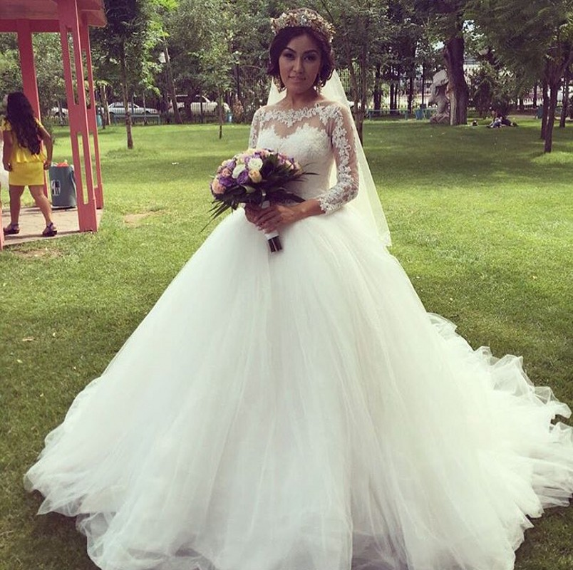 Elegant Beautiful Puffy Ball Gown Wedding Dresses 2016 Sheer Top O Neck  Caps Sleeve Bride Dress Princess Wedding Gown L7332016-in Wedding Dresses  from ... d9ca32c84786