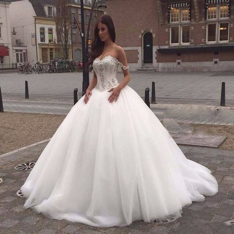 White Ivory Ball Gown Wedding Dresses Tulle Sweetheart Off the Shoulder Lace Appliques Crystal Beaded Bride Gowns Custom Made in Wedding Dresses from Weddings Events