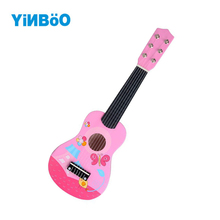 Купить с кэшбэком Baby Toys For Children 21 Inch 6 String 12 scale Wooden Guitar ukulele Musical Instruments Educational Toy For Children Gifts