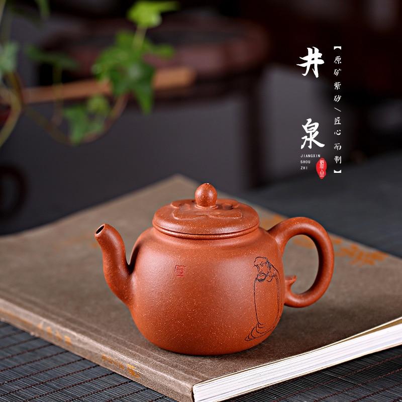 Ouvrier de Yixing célèbre pot d'argile pourpre, est une théière authentique faite à la main pure avec du thé 260cc dans le Nijingquan de descente