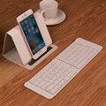 Portátil Mini Teclado Sem Fio Bluetooth Dobrável Teclado para Tablet Laptops com O caso do PLUTÔNIO Suporte Do Telefone Móvel