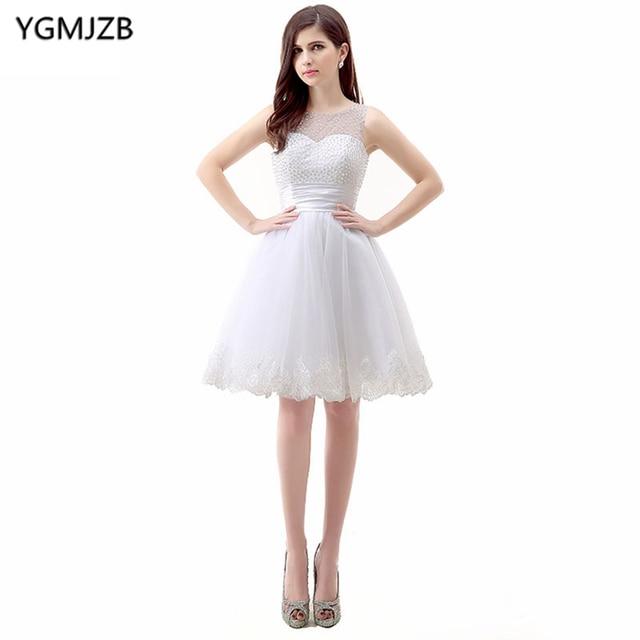 2962c0b63 Vestido blanco Vestidos de cóctel 2018 una línea Cap manga impresionante  apliques moldeados Encaje fiesta vestido