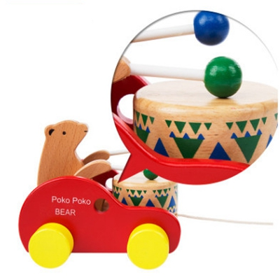 цена  Children drag the bear to beat the drums to pull the trailer recommended to learn the creeping period baby wooden puzzle toys  онлайн в 2017 году