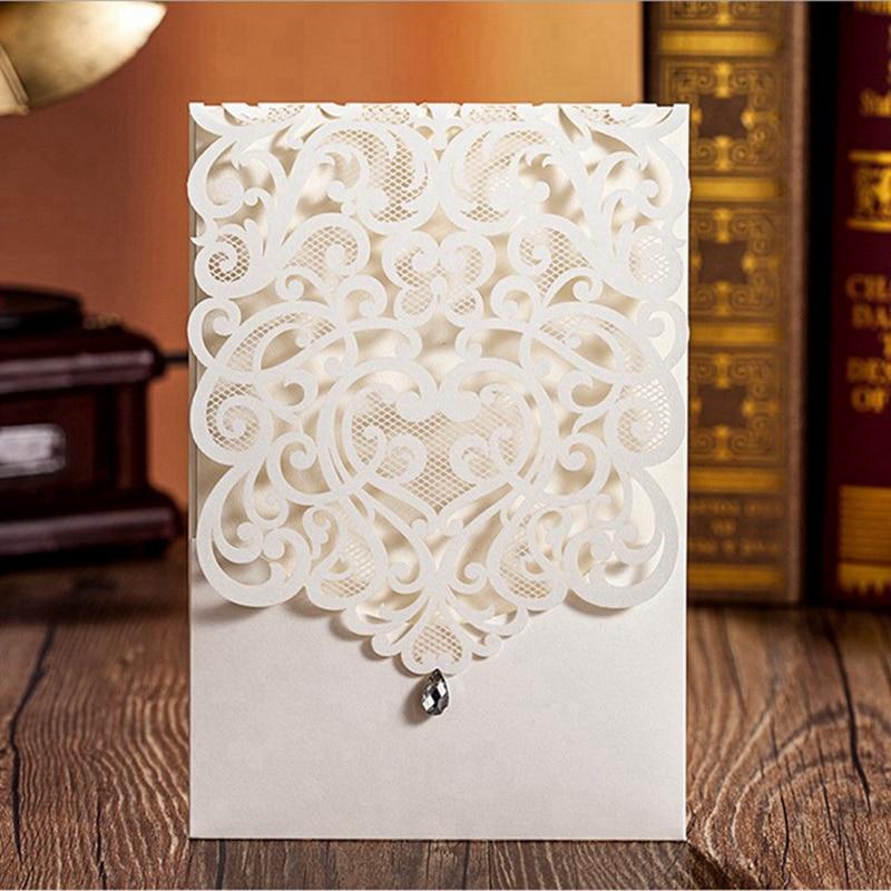 100pcs elegant vertical ivory white wedding invitation with rhinestone laser cut flower cw5001