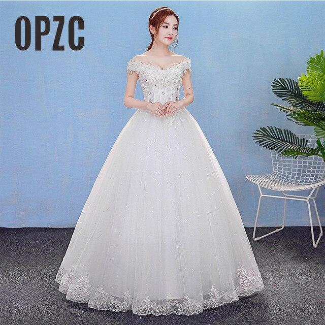 017edcb316e4 OPZC 2018 White Floor-Length Long Wedding Dress Boat Neck Off the Shoulder  Sweetheart Elegant Design Backless vestido de festa