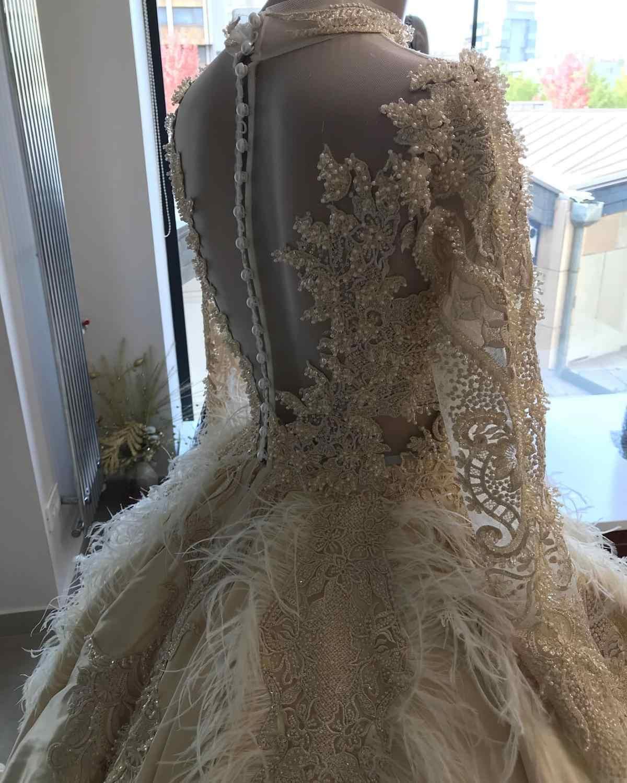 , Eleganckie i luksusowe dostosowane koronki pióra frezowanie suknia ślubna 2019 Illusion suknie ślubne Robe De Mariee