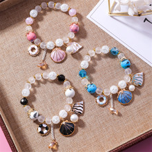Korean version of the shell ocean wind ceramic bracelet fresh crystal glass colorful beaded jewelry female