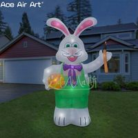 standing lighting inflatable Easter bunny with an orange egg ,green inflatable rabbit for easter decoration