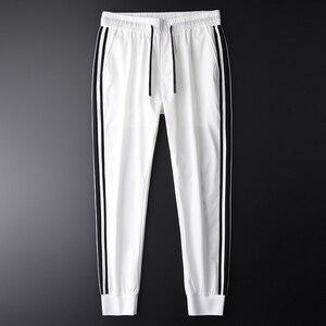 Image 1 - Minglu Men Jogger Pants Luxury Fashion Side Contrast Color Casual Pants Men Plus Size 4xl Summer Slim Fit Sport Mens Trousers