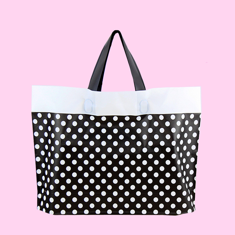 High grade black and white dot plastic clothing, handbags, thickening men and women's clothing store, packaging sling bag, gift image