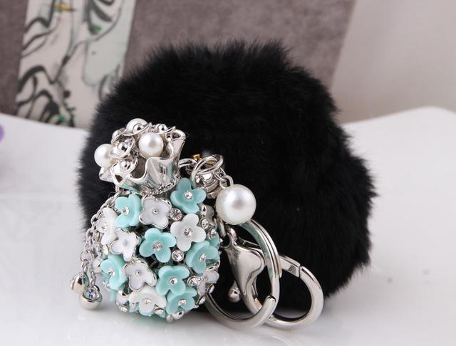 Ventas calientes chaveiro pom pom de imitación llavero conejo bolsa bulbo piloso ornamentos del coche bola de piel de zorro colgante Key anillo negro