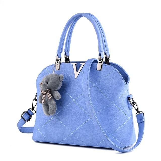 Free shipping 2017 new women PU handbag. Fashion Bear Strap solid shoulder bag. Large capacity messenger bag. size 28 * 21 * 12