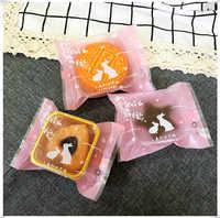 Gommage version coréenne de lapin machine joint vache roulement biscuit sac jaune d'oeuf lune gâteau emballage sacs + plateau en or 95-100 ensembles