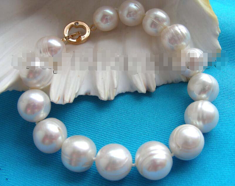 A 8.5 Genuine Natural 13mm White Pearl Bracelet 14KGPA 8.5 Genuine Natural 13mm White Pearl Bracelet 14KGP