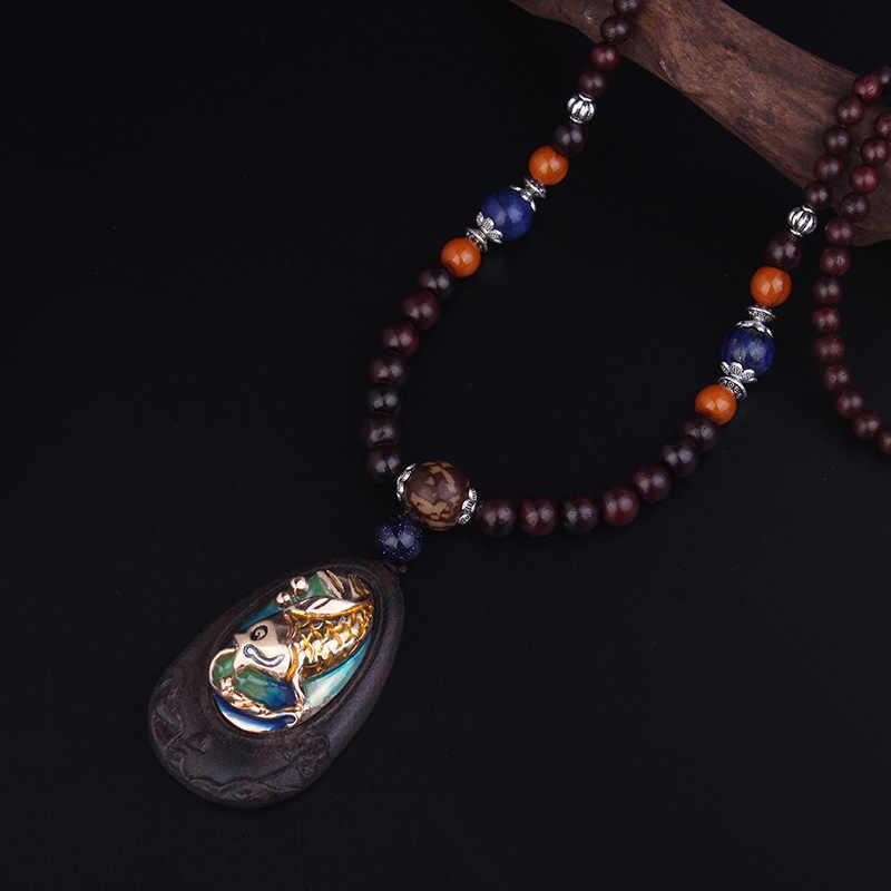 Perhiasan wanita hitam Rosewood kayu perhiasan kalung vintage, Sedikit ikan mas melompat gantry mutiara kilau Buddha kalung etnik