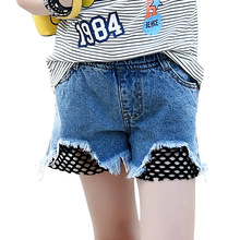 Childrens wear 2019 new summer fashion girls black net wild hot pants in the big children casual personality hole denim shorts