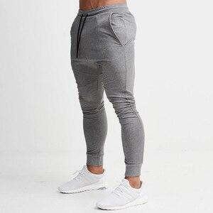 Image 2 - Pantalons de Jogging rouge hommes rayé Sport pantalons de survêtement pantalons de course pantalons de gymnastique hommes coton survêtement Fitness survêtement pantalon de musculation