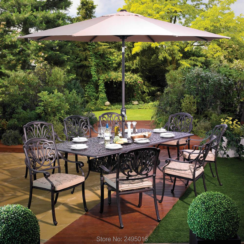 set of  9cps outdoor furniture solid-cast dining set table and chairs in the yard or garden without umbrella