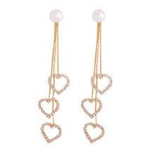 цена на Golden Hollow Out Heart Long Drop Earrings For Women Elegant Bohemia Crystal Heart Pendant Tassel Earring Bijoux
