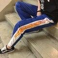 Venta caliente del diseño de corea de la novedad de Impresión llama Harajuku suelta pantalones Rectos ocasionales de los hombres y mujeres de cintura elástica pantalones de hip hop