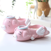Very cute pink angel pig candy storage box Fun cartoon Flying pig resin storage home decoration