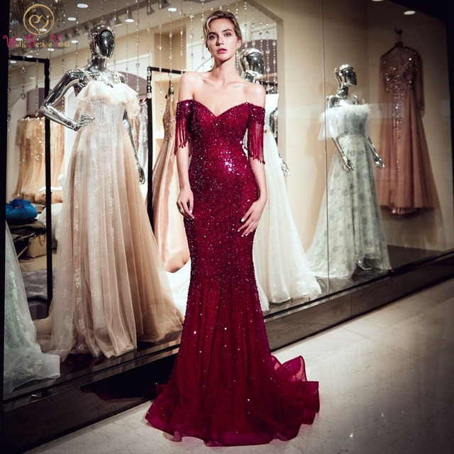 Walk Beside You Champagne Celebrity Dresses Burgundy Sequined Beads Bling  Sparkle Mermaid Off Shoulder Short Sleeves Tassel Prom df125b5289c0
