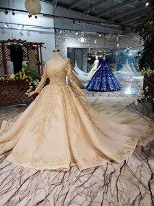 Image 4 - LS11555G Golden Trouwjurken Gown Met Bruiloft Sluier O hals Lange Mouw Bloemen Bridal Dress Met Trein فساتين طويله