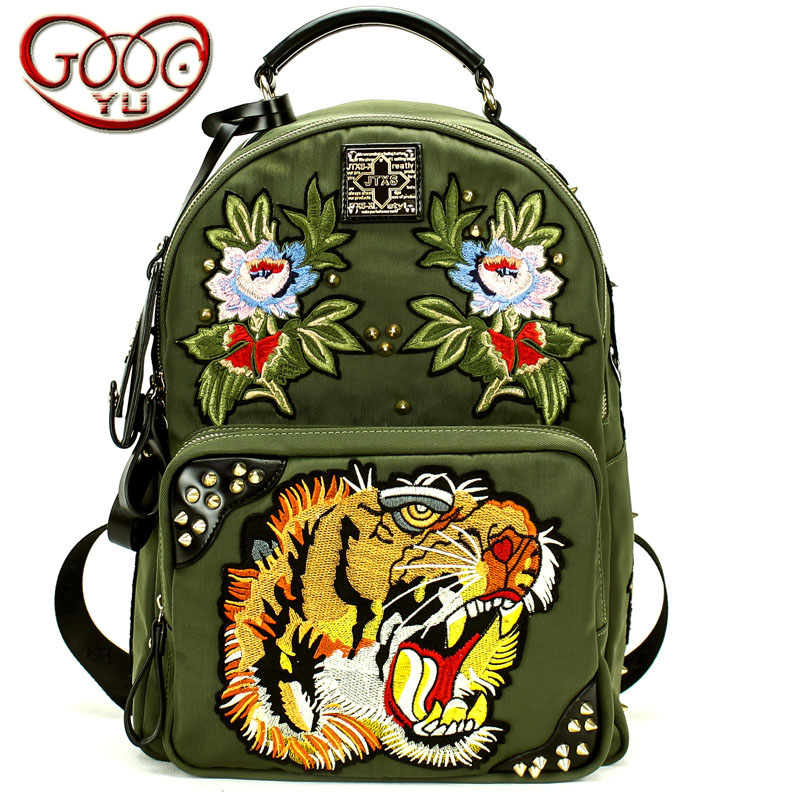 Rivet lion head and flower embroidery exquisite patterns decorated canvas backpack women / men Universal travel bag school bag embroidery basis book 500 kinds of three dimensional embroidery patterns