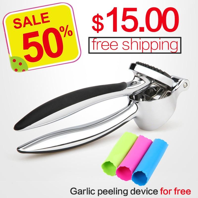 Acero inoxidable 304 # apretón de mano rápido ajo prensas de jengibre trituradora Herramienta de cocina Manual dispositivo de peeling de ajo envío gratis