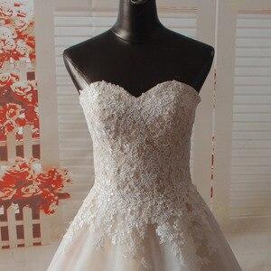 Image 3 - Vestido de novia SF1129, de muestra Real, corte en A, escote Corazón, apliques en el escote, vestidos de boda con dobladillo ancho