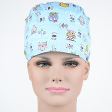 surgical scrub caps ,  100% cotton with sweatband in light blue with night owls