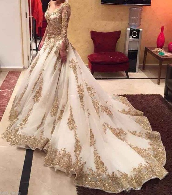 Stunning white and gold wedding dresses with beadings lace long stunning white and gold wedding dresses with beadings lace long sleeve wedding dress 2017 arabic dubai junglespirit Gallery