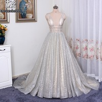Spaghetti Straps A Line Deep V Neck Court Train Open Back Champagne Sequined Prom Dress With