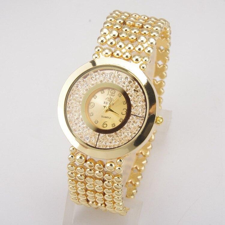 2017 New Fashion Luxury Women Rhinestone Full Steel Gold Bracelet Quartz Watch Women Dress Diamond Watch Ladies Wristwatches