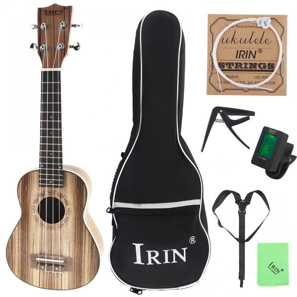 21 Inch Soprano Ukulele Zebra Wood 15 Fret Four Strings Guitar Bag Tuner String Strap Cloth