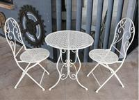 The balcony table and chair combination is simple recreational iron art folding hollow out chair outdoor courtyard iron chair .