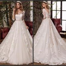 18529a63b5 Vestido De novia De encaje apliques una línea De cuello en V vestidos De  novia 3 4 mangas A través De novia trajes De novia traj.