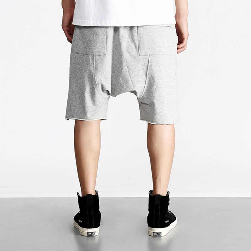 cf1dad32 ... Men harem shorts hiphop kanye west justin bieber style short sweatpants elastic  waist zipper pockets man ...