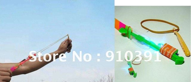Free Shipping novelty LED flying arrow umbrella catapult slingshot,out door flashing toys.price depend on the quantity.