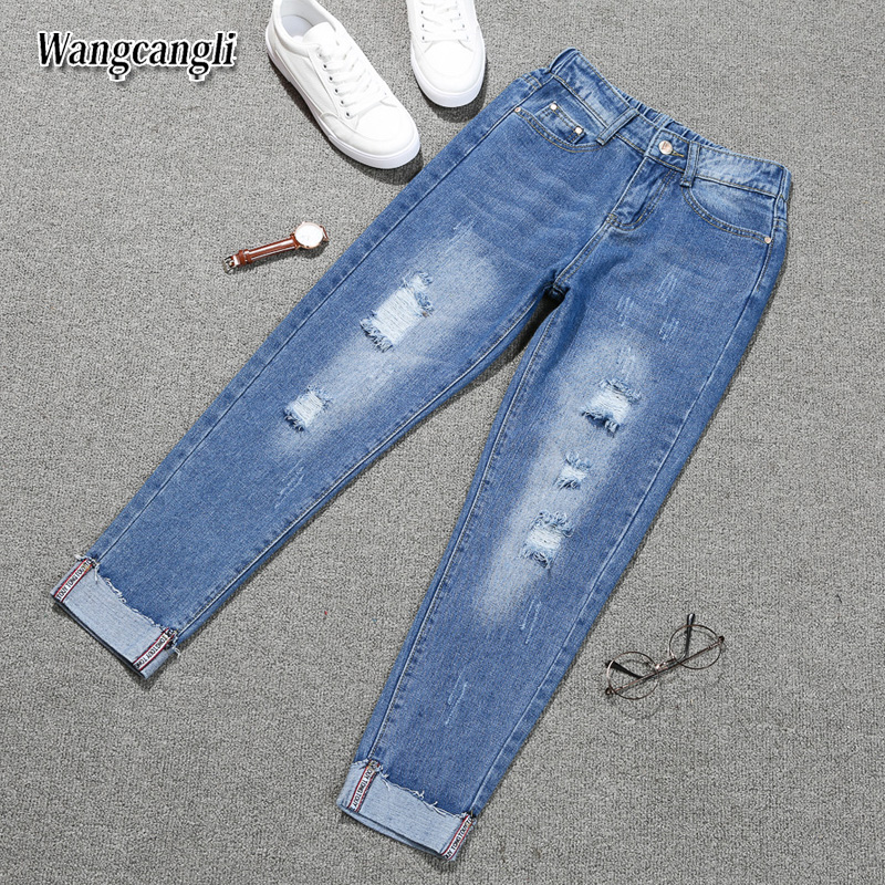 HTB1efVgg7yWBuNjy0Fpq6yssXXa6 Fashion Large size women's denim nine pants 2018 spring and summer high waist hole 5XL Blue women's elastic feet pants 015#