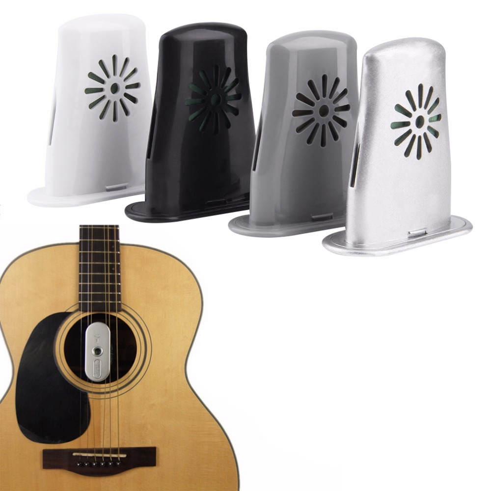цена 1pc New Acoustic Guitar Sound Holes Humidifier Moisture Reservoir Useful free shipping онлайн в 2017 году