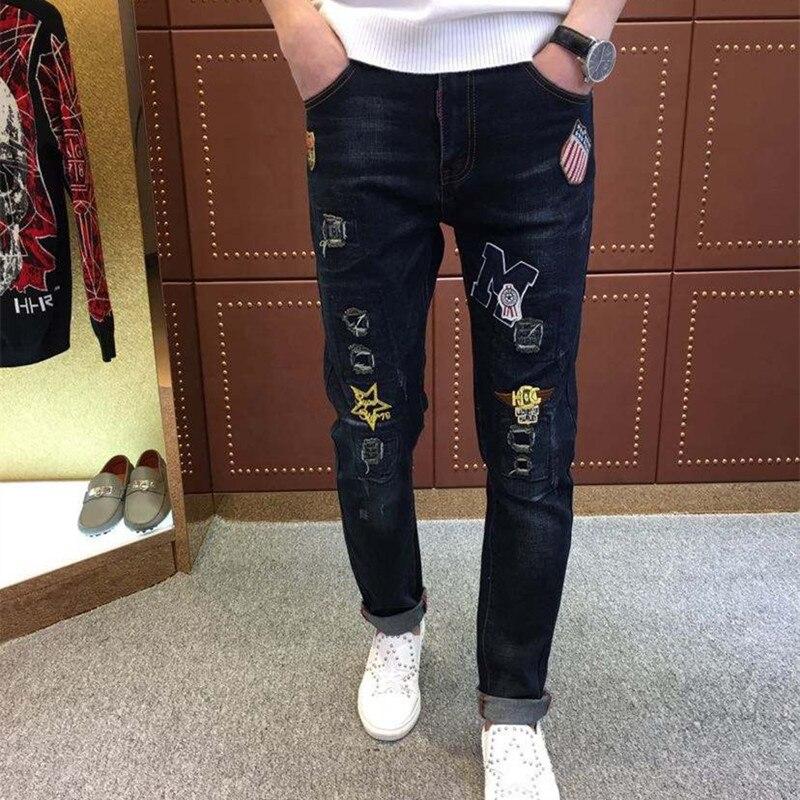 ФОТО new winter brand hole patch small straight leg jeans label male Black Slim Metrosexual long pants
