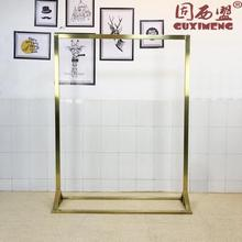 Stainless Steel Gold Display Frame in Landing Side Hanger of High-end Clothing Store Womens